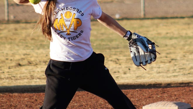 Alamogordo's Taylor Murphy throws over to first base during practice Thursday afternoon at the Grady Fields.