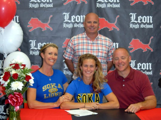 Leon senior Talise Jager-Sumner committed to play soccer in the fall for Soka University of America in Aliso Viejo, California. She was a first-team All-Big Bend defender this winter. Talise is pictured with her parents, Regan Jager and Dylan Sumner, and Leon coach Tony Kidd.