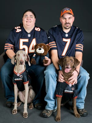 Snow and Anton Aubel pose with their dogs Cheyenne (left) and Yepa (right).