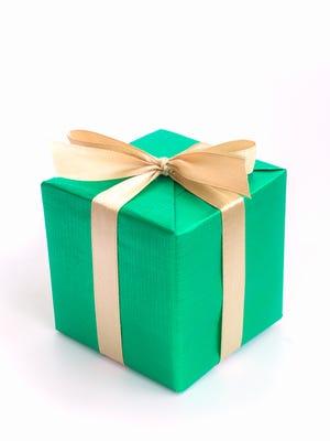 Green gift box with gold ribbon.