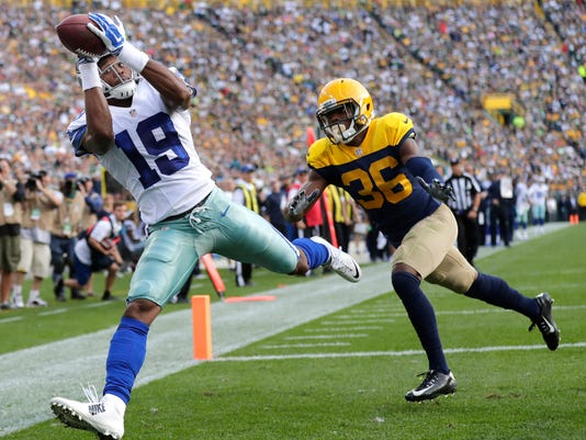 280bdf975 Dallas Cowboys receiver Brice Butler catches a second quarter touchdown  pass in front of Green Bay Packers cornerback LaDarius Gunter.