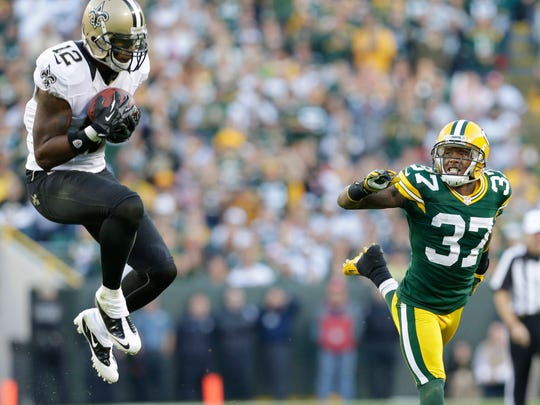 Saints wide receiver Marques Colston pulls down a long first down reception against Packers cornerback Sam Shields.