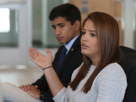 Mariana Ortiz, right, seated with fellow student Brian Basu, talks about attending classes at the University of Rochester. A group of seven students are all studying at the university this semester following the devastating hurricane that hit their home of Puerto Rico.