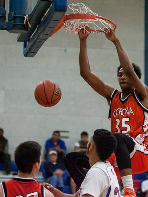 Marvin Bagley of the Corona del Sol Aztecs dunks during the first half of their game against the Phoenix North Mustangs at North High School in Phoenix on Dec. 5, 2014.