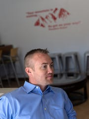 Aztec City manager Josh Ray talks during an interview on March 8 at the Aztec business HUB.