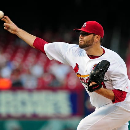 Aug 20, 2014; St. Louis, MO, USA; St. Louis Cardinals starting pitcher Lance Lynn (31) throws to a Cincinnati Reds batter during the first inning at Busch Stadium. Mandatory Credit: Jeff Curry-USA TODAY Sports