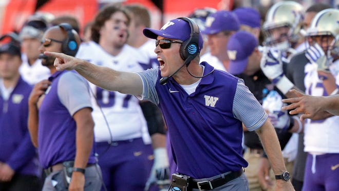 Washington head coach Chris Petersen shouts to his team in the second half of an NCAA college football game against Utah, Saturday, Oct. 29, 2016, in Salt Lake City.