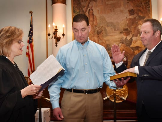 Union County Sheriff Peter Corvelli holds the Bible