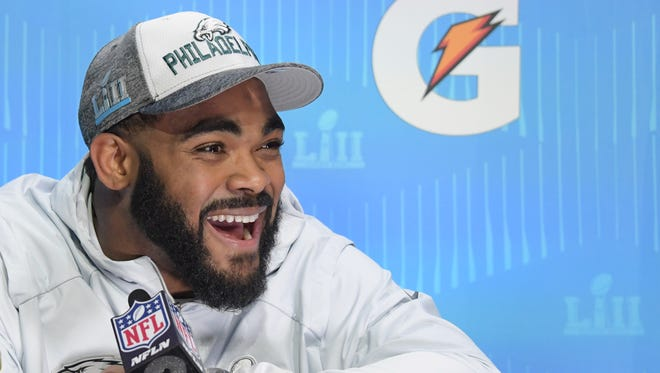 Eagles defensive end Brandon Graham is interviewed during Super Bowl LII opening night at Xcel Energy Center in St. Paul on Monday.