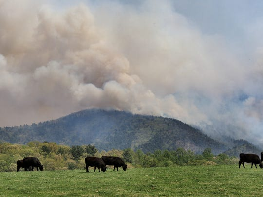 Smoke rises from the Blue Ridge as seen from Raphine, Va., Friday, May 4, 2018. The blaze now has burned 1,000 acres and began Thursday with a car fire.