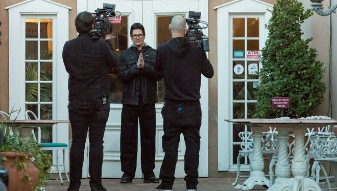 "The Travel Channel's ""Ghost Adventures"" host Zak Bagans films at the entrance of the Double Eagle on Tuesday, January 10, 2017."