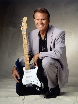 Glen Campbell shown in later years with his guitar.