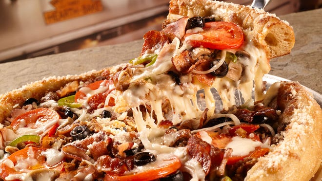 The House Special Pizza features a red sauce base with mozzarella cheese, pepperoni, sausage, ground beef, ham, Applewood smoked bacon, mushrooms, black olives, Roma tomatoes, green peppers and onions.