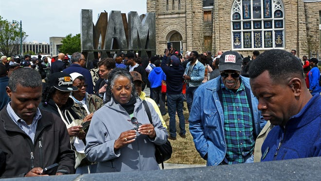 April 5, 2018 - Wearing his I AM A MAN cap, former santiation worker Ozell Ueal looks for his engraved name during the I AM A MAN Plaza unveiling adjacent to Clayborn Temple on Thursday. The permanent installation honors the 1968 sanitation workers.