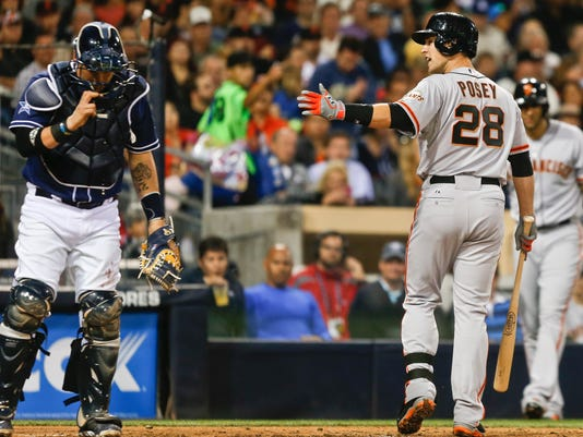 San Francisco Giants' Buster Posey argues with home plate umpire Gabe Morales after being called out on strikes in the seventh inning of a baseball game against the San Diego Padres, Saturday, April 19, 2014, in San Diego. (AP Photo/Lenny Ignelzi)