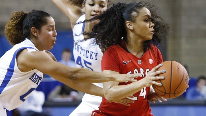 Georgia's Marjorie Butler, right, tries to escape the defense of Kentucky's Jennifer O'Neill, left, and Alyssa Rice during the first half of an NCAA college basketball game, Sunday, Feb. 1, 2015, in Lexington, Ky. (AP Photo/James Crisp)