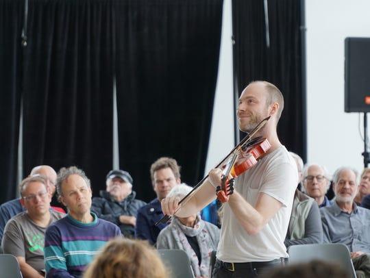 Fiddler Cleek Schrey smiles during a performance at