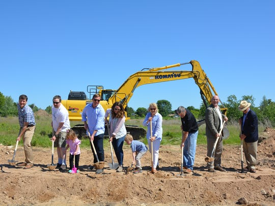 Participants at the June 11 groundbreaking for Tall