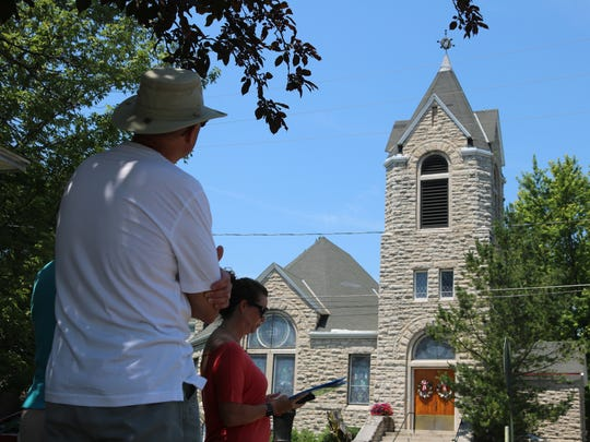 Erin Sandvick, of the Marblehead Peninsular Branch Library, tells the story ofLucien M. Clemons' connection to the astrolabe atop theFirst United Church of Christ.