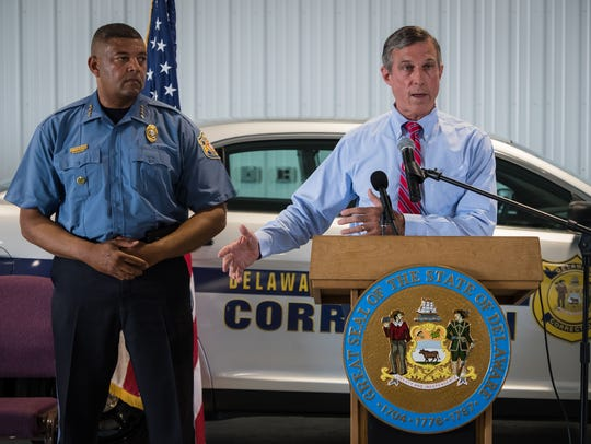 Gov. John Carney holds a press conference with Department of Correction Commissioner Perry Phelps in 2017.