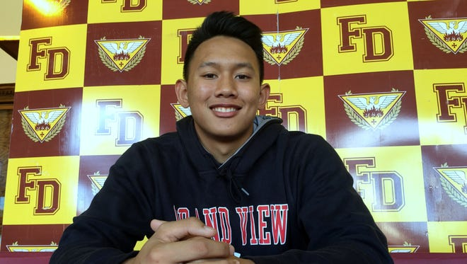 Father Duenas Friar' Eric Ada signed his letter of intent to play for the Grand View Vikings on Monday, May 2 at the Father Duenas Phoenix Center.