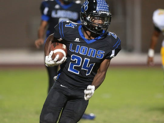 Cathedral City's James Green runs against Coachella Valley, August 26, 2016.