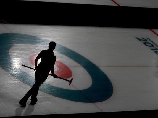 Canada's Lisa Weagle stands on the ice during a women's curling match against China at the 2018 Winter Olympics in Gangneung, South Korea, Tuesday, Feb. 20, 2018. (AP Photo/Natacha Pisarenko)