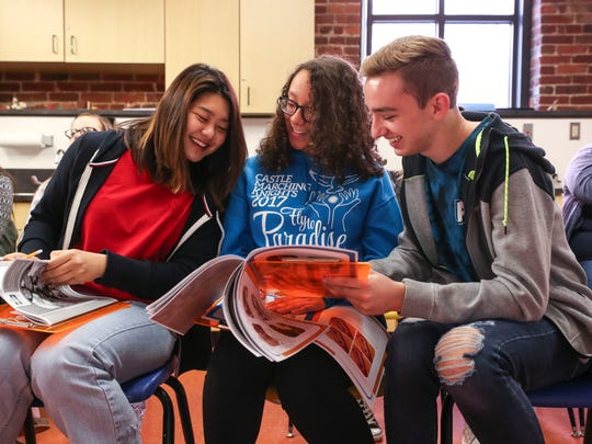 Castle High School seniors Jackson Creslack, right, Lexi Dickman, center, and An-Ping Yu laugh as they look at notes while watching the operation.