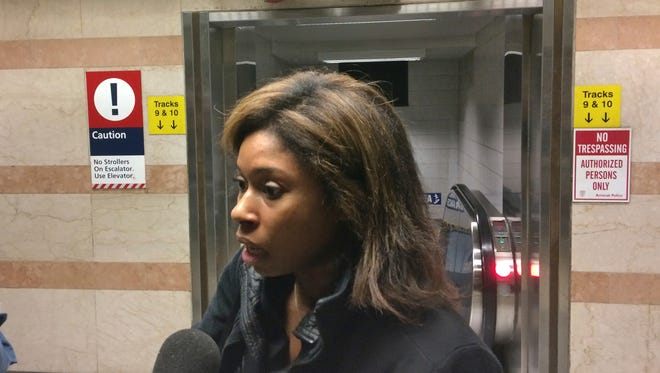 Rail commuter Tiffany Maxine talks to reporters at New York City's Penn Station about the April 3, 2017, derailment aboard her NJ Transit train.
