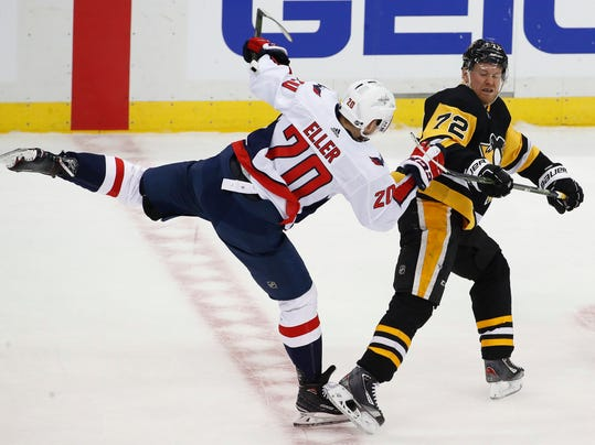 Pittsburgh Penguins' Patric Hornqvist (72) collides with Washington Capitals' Lars Eller (20) in the first period of an NHL hockey game in Pittsburgh, Sunday, April 1, 2018. (AP Photo/Gene J. Puskar)