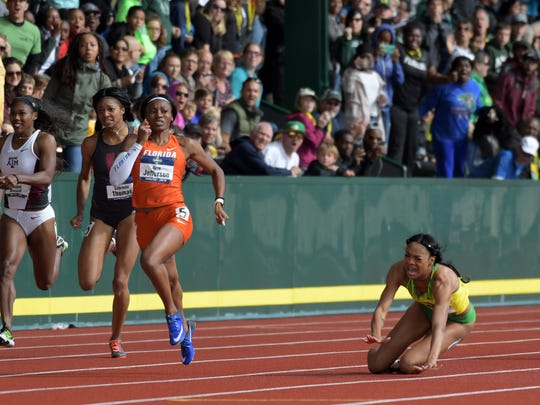 Oregon's Deajah Stevens stumbles near the end of the