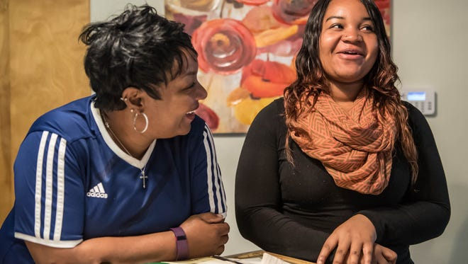 Dominique Patton, 18, talks with her mother Leitia about Dominique's bone cancer in her left leg that was discovered at age 4.