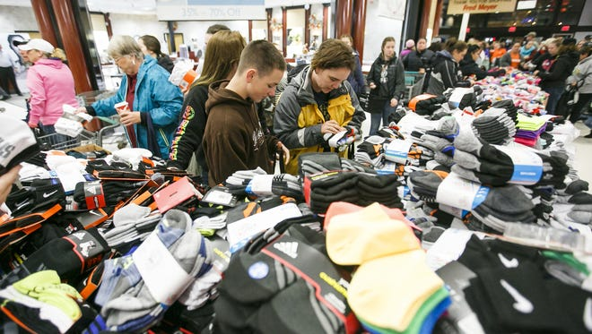 Carole Ashworth, right, and her son Caylib Newman, left, browse through the many bins of socks available at the Fred Meyer on Market and Lancaster on Black Friday, Nov. 25, 2016.