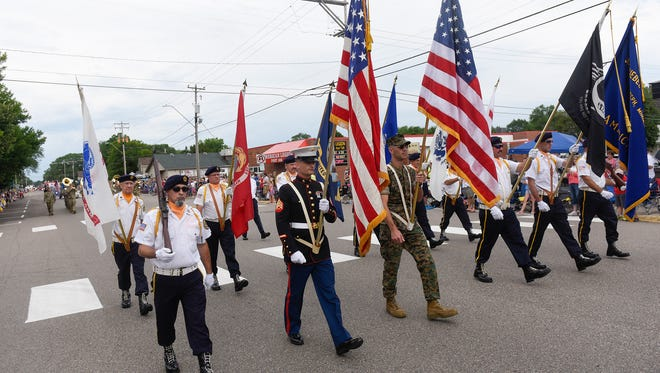The color guard leads the parade Wednesday in St. Joseph.