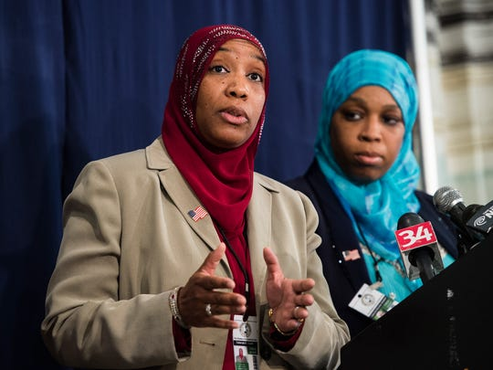 Lawyers for The Muslims of America Tahirah H. Clark, left, and Tahirah Amatul-Wadud speak during a news conference last summer in Binghamton.