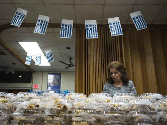 Gloria Ganim of Vestal stacked pastries for the upcoming Grecian Festival at Greek Orthodox Chruch of Annunciation in Vestal on Tuesday afternoon.