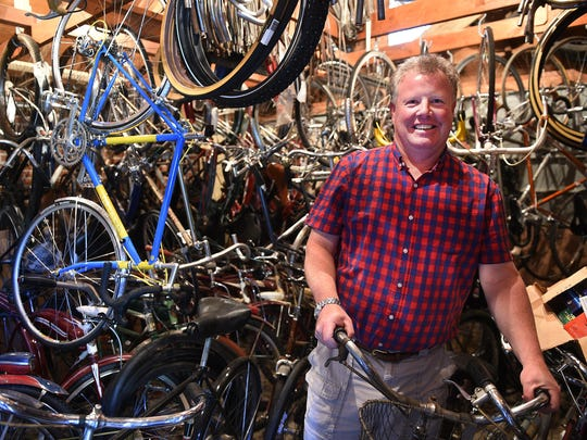 "Scott ""Coot"" Callahan poses for a portrait with some of his vintage bikes in his garage in Reno on June 16, 2015."