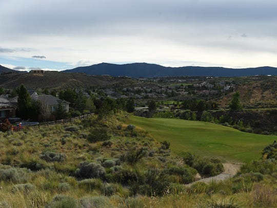 Homes and a golf course are seen surrounded by desert landscape at the Somersett development in northwest Reno on July 9, 2015.