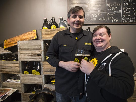 Binghamton Brewing Co. owners and spouses Kristen Lyons and Jason Gardner enjoy a glass of their beer.