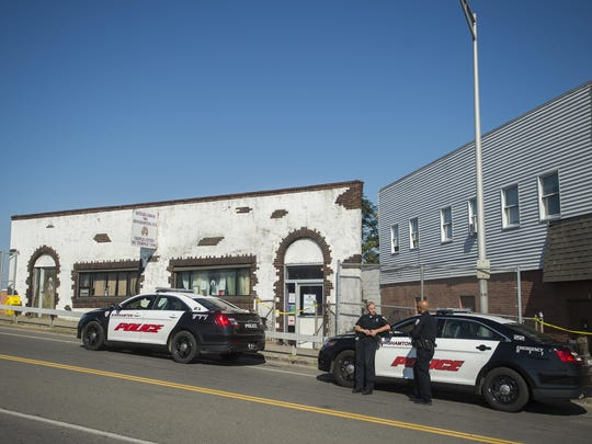 Binghamton police officers outside the Antler Lodge — later closed under the city's lockdown law — after a July 24, 2015, fatal shooting.