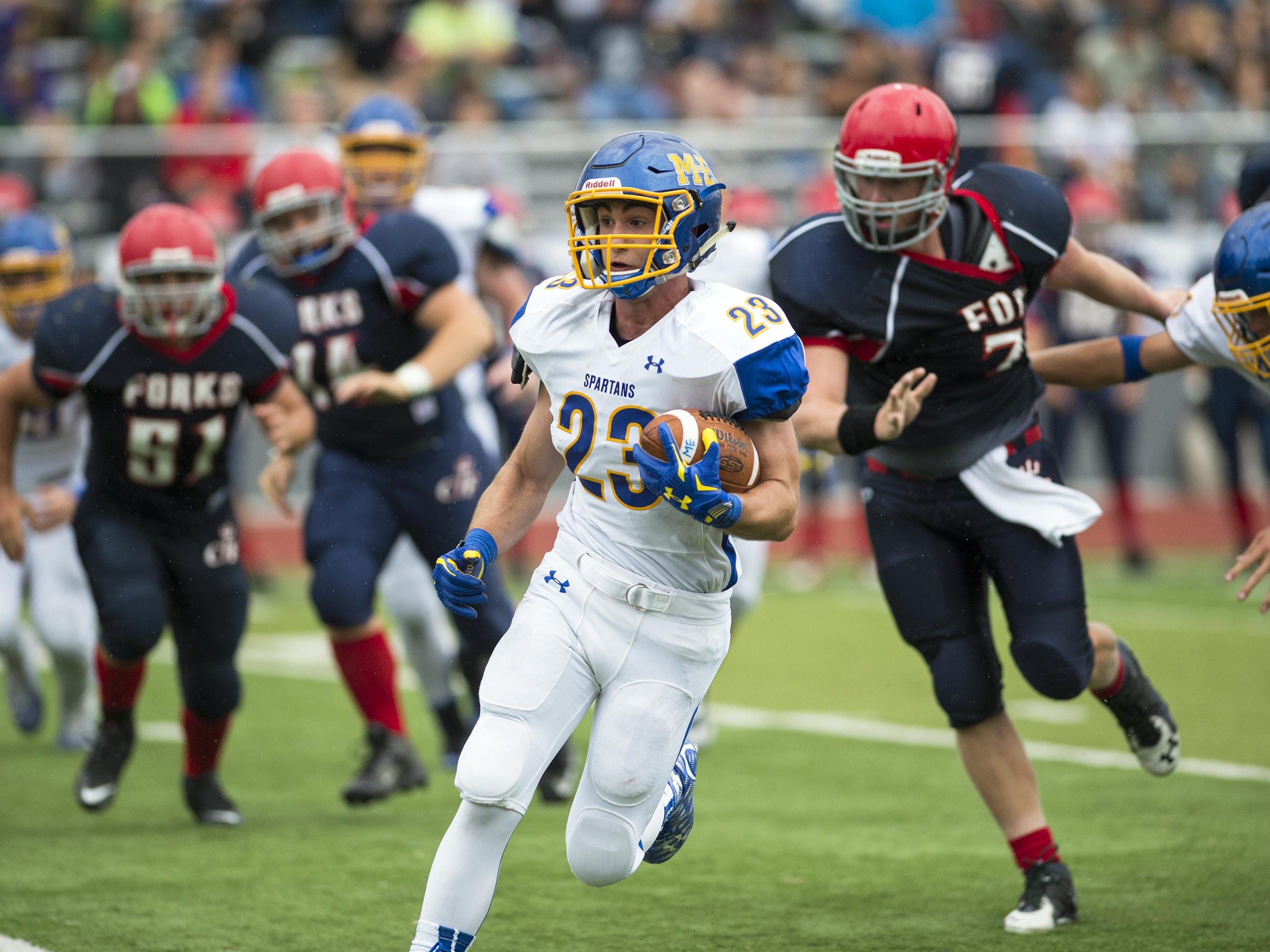 Maine-Endwell running back John Cerra rushes the ball during the third quarter against Chenango Forks on Saturday, Sept. 12, 2015. M-E defeated Chenango Forks 28-21.