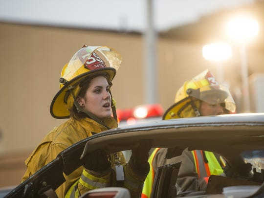 Miranda Currier, 19, helps remove a car roof during a training exercise.