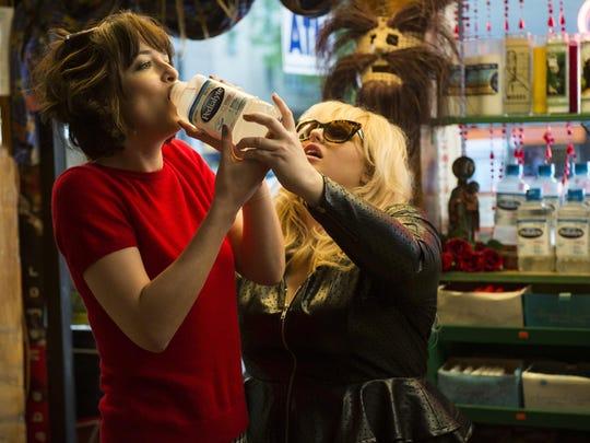 "Dakota Johnson, left, and Rebel Wilson in a scene from ""How to Be Single."""