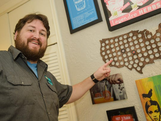 Jay Ducote uses a wooden map of America with holes to collect bottlecaps from beer-drinking adventures.