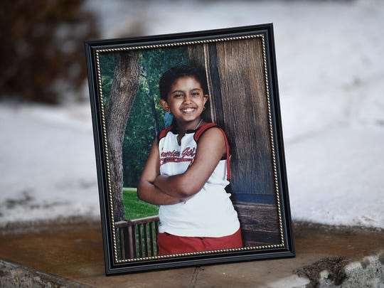A photo of Aden Hailu as a young child is seen near an entrance to Argenta Hall on the University of Nevada campus in Reno on Jan. 9, 2016. Hailu lived in Argenta Hall while a student at the university.