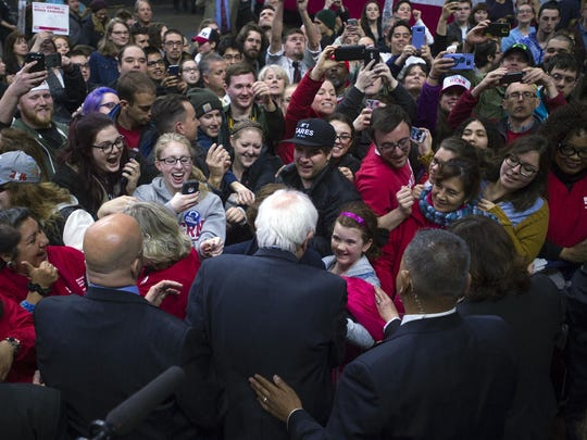 People gather around Democratic presidential hopeful Bernie Sanders after his speech Monday at Floyd L. Maines Veterans Memorial Arena in Binghamton.