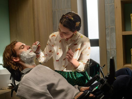 "Sam Claflin, left, and Emilia Clarke star in ""Me Before You."""