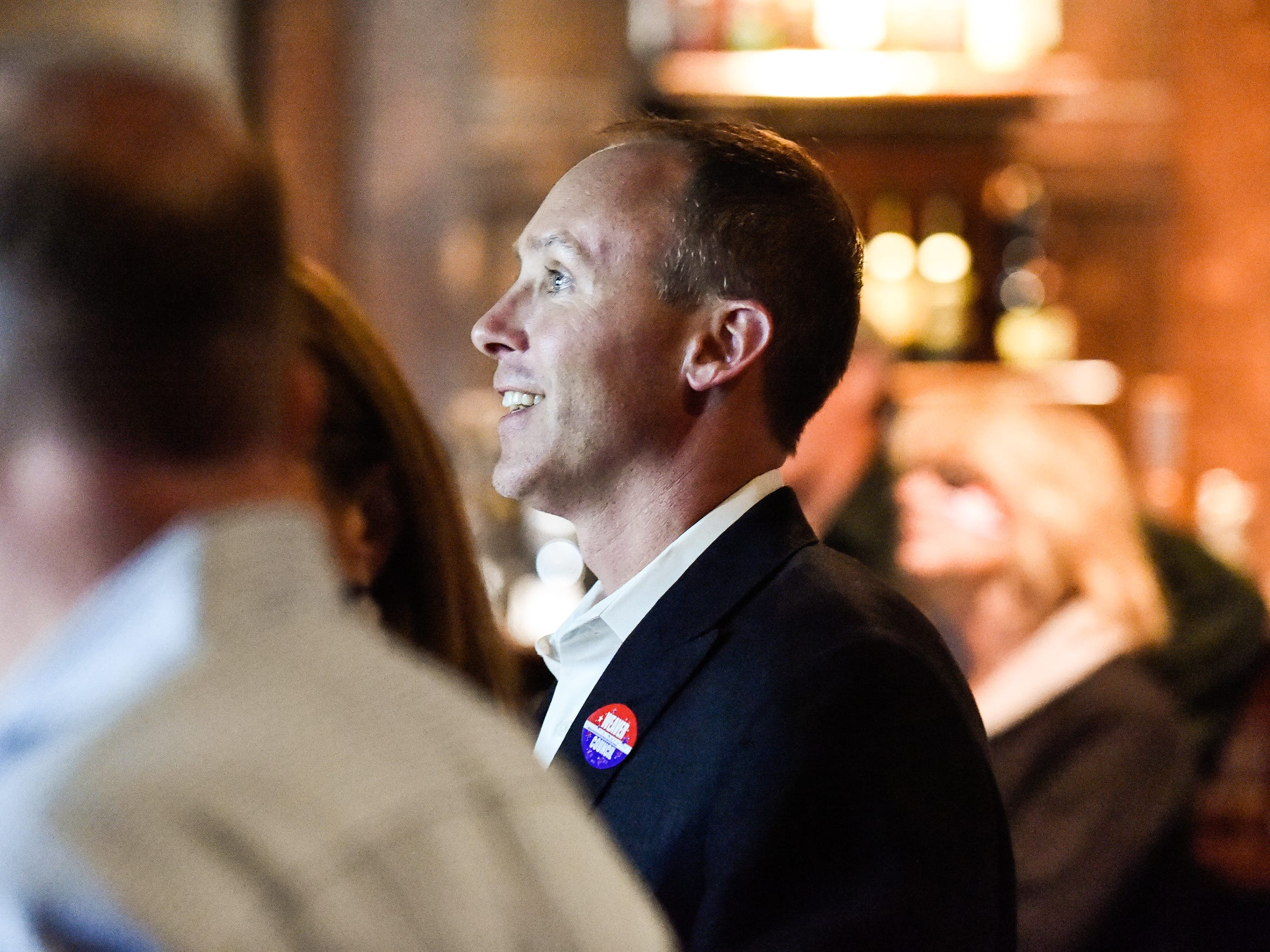 FILE - Jonathan Weaver watches the large television screen at Ri Ra Irish Pub as votes come in declaring him one of three winners of the City Council At-Large seats Tuesday night, November 3, 2015. The other 2 winners were Michelle Mercer and H. Dan Adams. Weaver was the top vote getter with 11,237 votes.