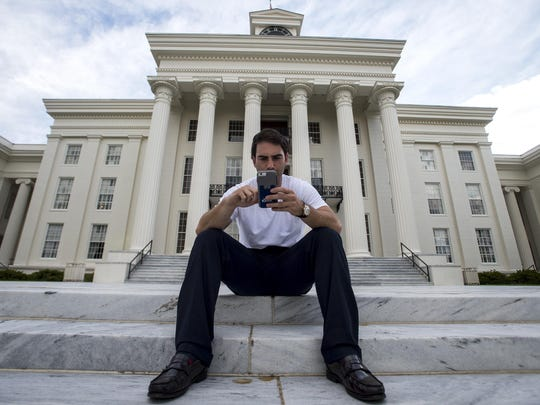 "Graham Roderick plays ""Pokemon Go"" on Thursday, Jul. 14, 2016 outside the Capitol building in Montgomery, Ala."