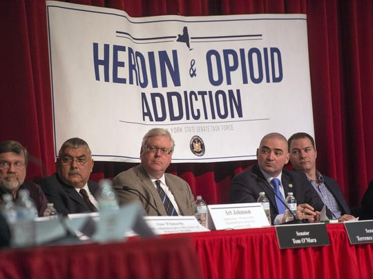 Panel members listen during a Senate Joint Task Force on Heroin and Opioid Addiction meeting on April 13 at Chenango Valley High School.